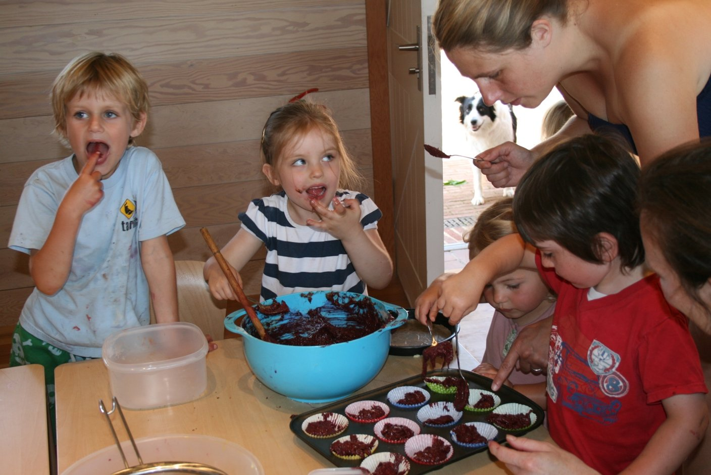 Images of children cooking beetroot and chocolate cakes in the Education room at Dixter Farm