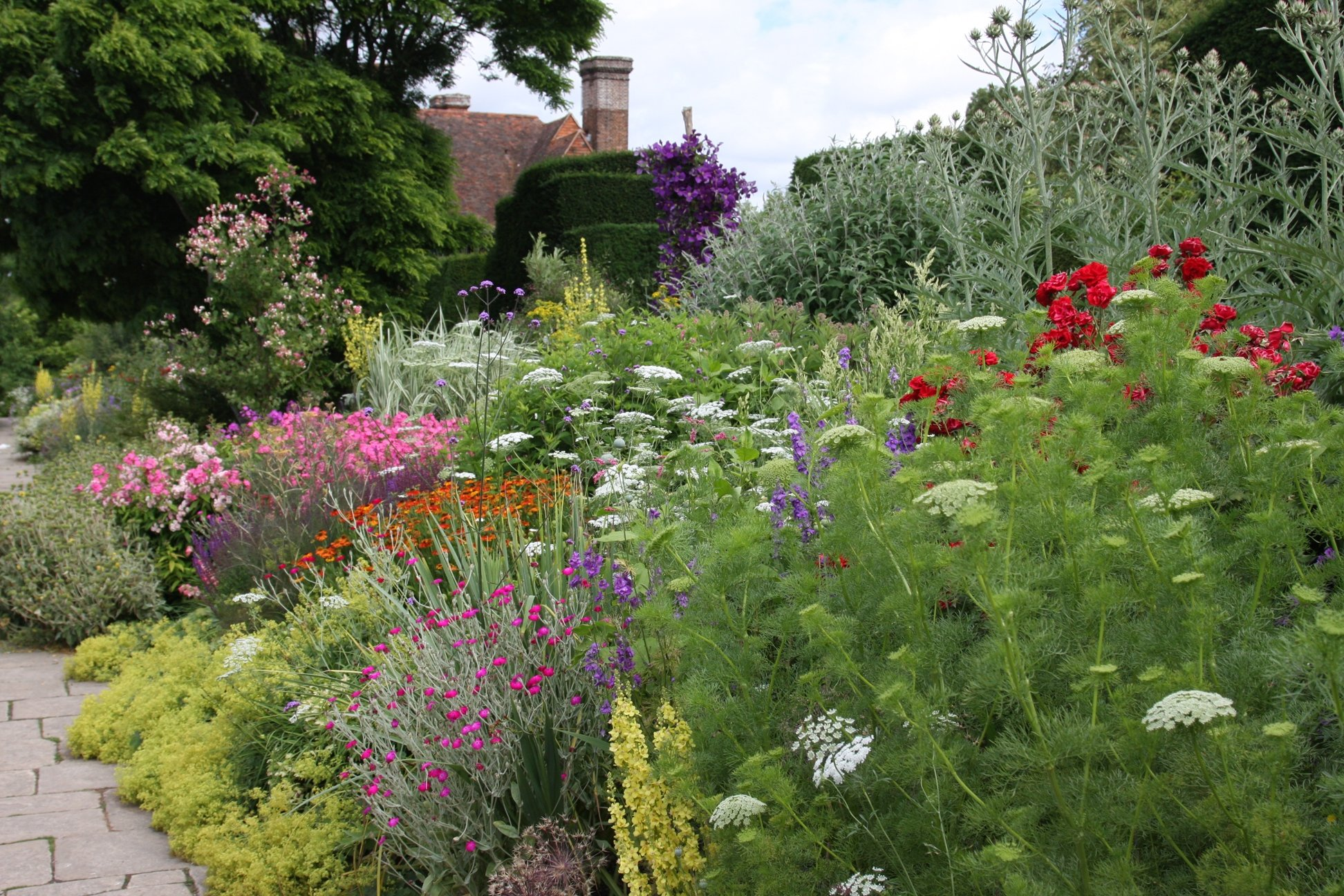Planting on the Long Border at Great Dixter in July by Fergus Garrett