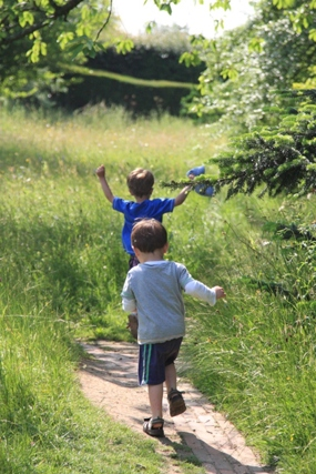 An image of preschool children in the meadow at Dixter