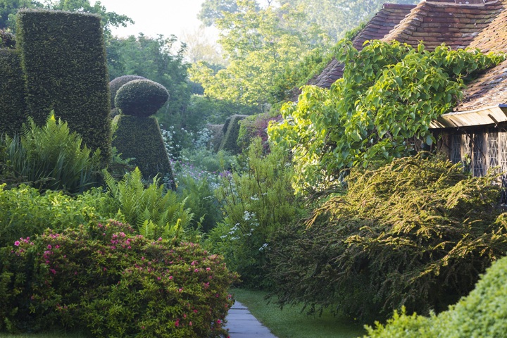 Outside the kitchen yard at Great Dixter by Claire Takacs