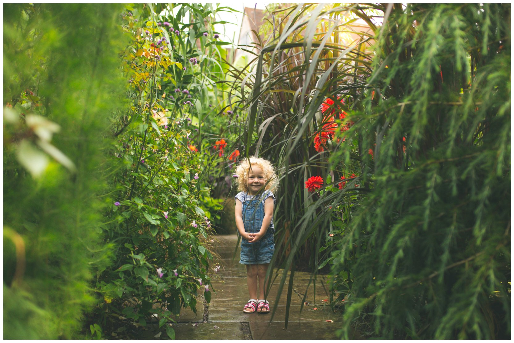 A child standing in the Exotic garden at Dixter